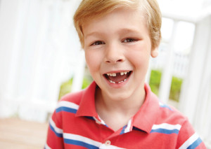 Smiling kid at Baton Rouge LA dentist after losing a tooth