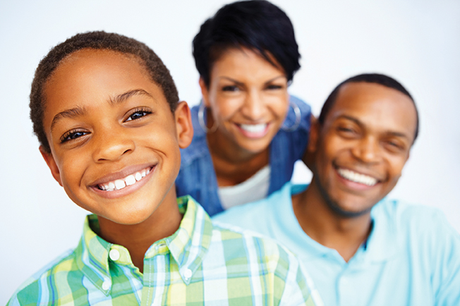 Smiling family after getting dental sealants at Baton Rouge LA dentist