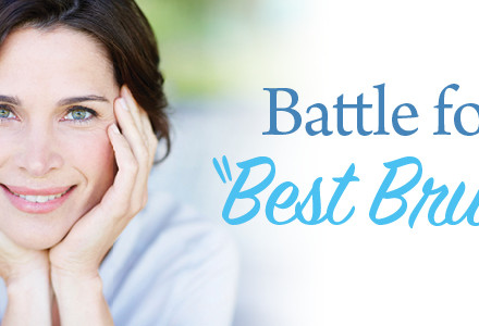 Smiling woman after deciding which is the best toothbrush to buy